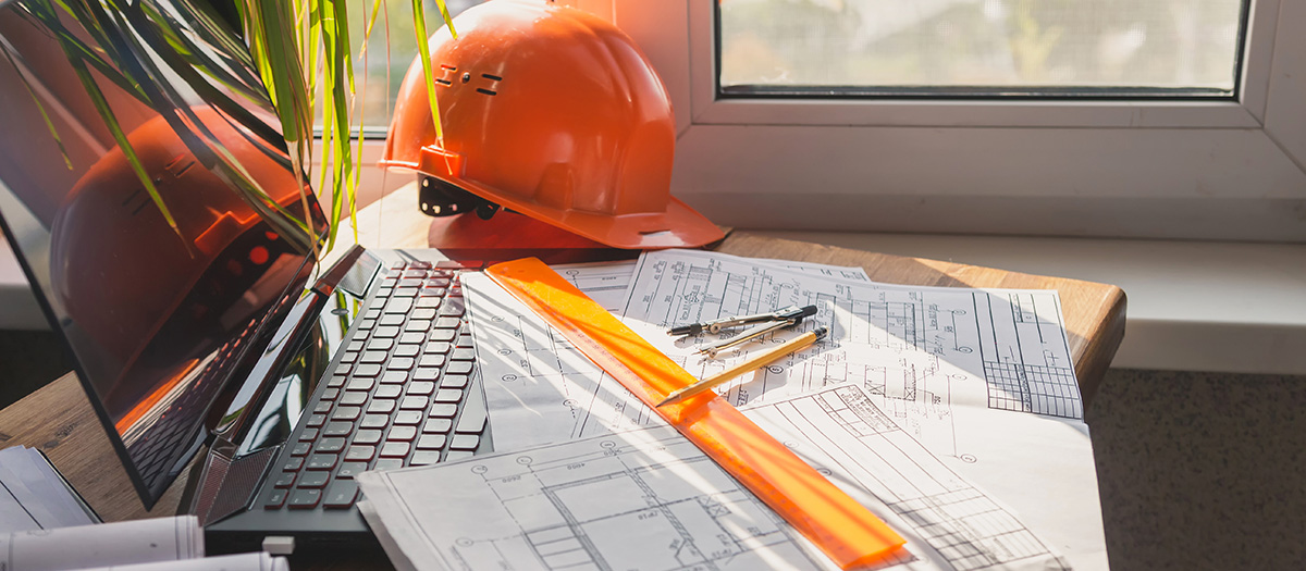 architect design working drawing sketch plans blueprints and making architectural construction model in home.